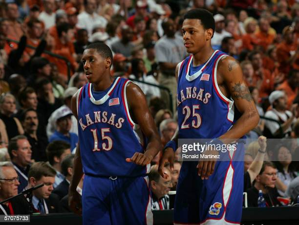 Mario Chalmers and Brandon Rush of the Kansas Jayhawks look on during a break in game action against the Texas Longhorns during the final of the...