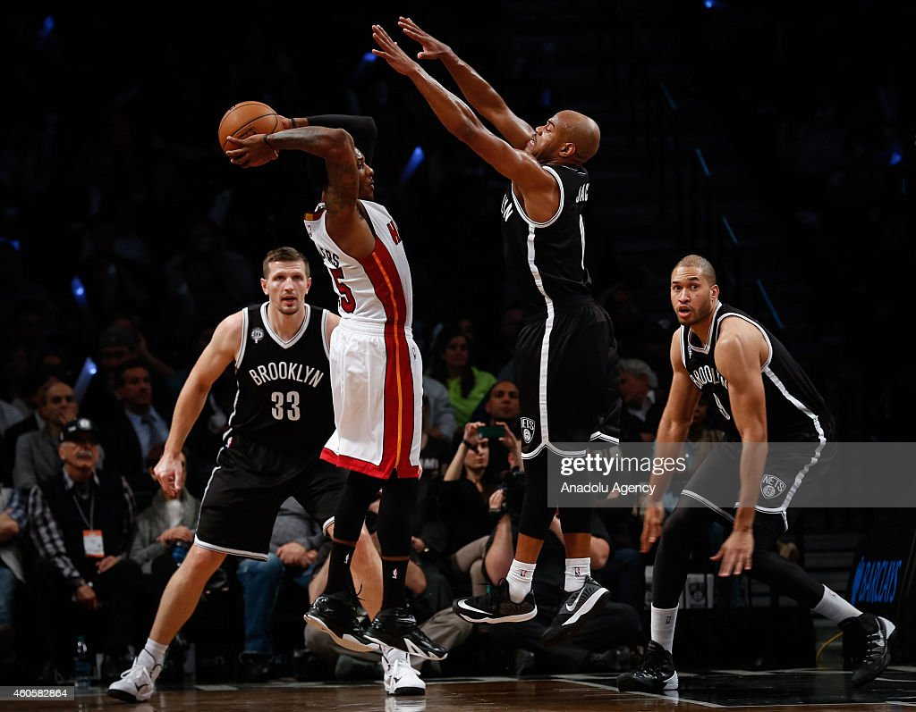 Mario Chalmers (L2) in action against Jarrett Jack (R2), Jerome Jordan (R) and Mirza Teletovic #33 of the Brooklyn Nets in action during NBA basketball game between Brooklyn Nets and Miami Heat at the Barclays Center in the Brooklyn Borough of New York City, on December 16, 2014.