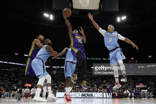 Mario Chalmers of the 3 Headed Monsters shoots the ball over Jamario Moon of the Triplets during the BIG3 Playoffs at Smoothie King Center on August...