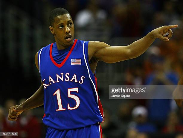Mario Chalmers of the Kansas Jayhawks reacts after scoring against the Texas Longhorns during the Big 12 Men's Basketball Tournament Finals on March...