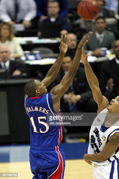 Mario Chalmers of the Kansas Jayhawks shoots and makes a three-pointer to tie the game to send it into overtime against the Memphis Tigers during the...