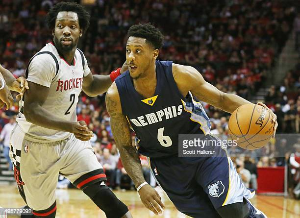 Mario Chalmers of the Memphis Grizzlies drives with the ball against Patrick Beverley of the Houston Rockets during their game at Toyota Center on...