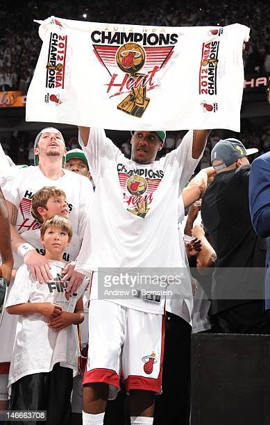 Mario Chalmers of the Miami Heat celebrates with a championships flag during Game Five of the 2012 NBA Finals between the Miami Heat and the Oklahoma...