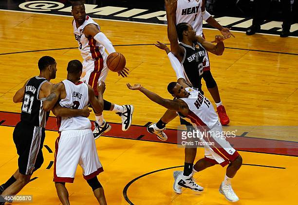 Mario Chalmers of the Miami Heat defends against Kawhi Leonard of the San Antonio Spurs during Game Three of the 2014 NBA Finals at American Airlines...