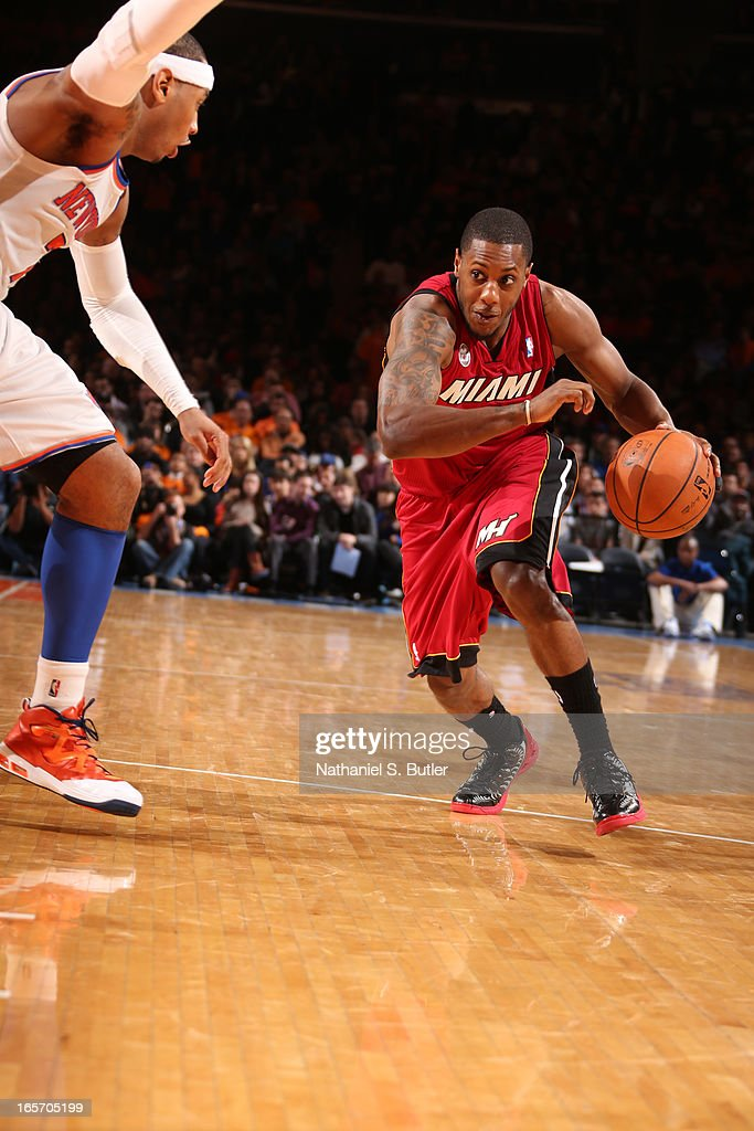 Mario Chalmers #15 of the Miami Heat drives to the basket against the New York Knicks on March 3, 2013 at Madison Square Garden in New York City.