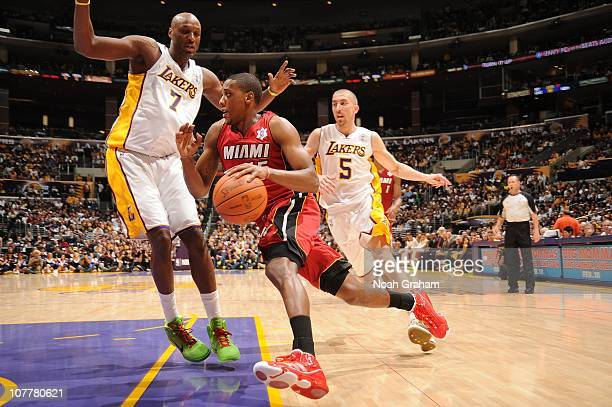 Mario Chalmers of the Miami Heat goes strong to the hoop against Lamar Odom of the Los Angeles Lakers at Staples Center on December 25 2010 in Los...