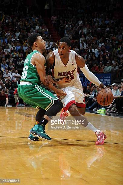 Mario Chalmers of the Miami Heat handling the ball during a game against the Boston Celtics at the American Airlines Arena in Miami Florida on Jan 21...