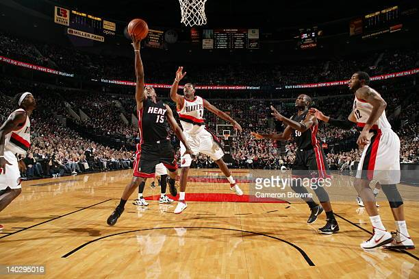 Mario Chalmers of the Miami Heat shoots a layup against Marcus Camby of the Portland Trail Blazers on March 1 2012 at the Rose Garden Arena in...