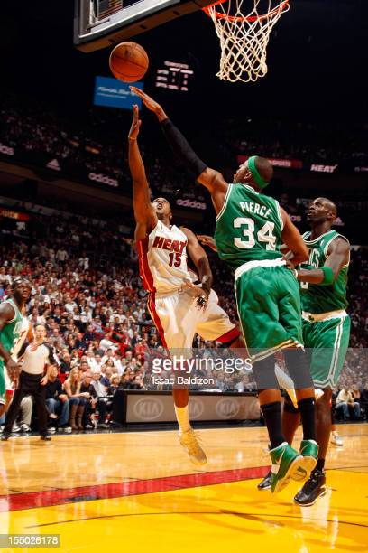 Mario Chalmers of the Miami Heat shoots against Paul Pierce of the Boston Celtics during the NBA game on October 30 2012 at American Airlines Arena...