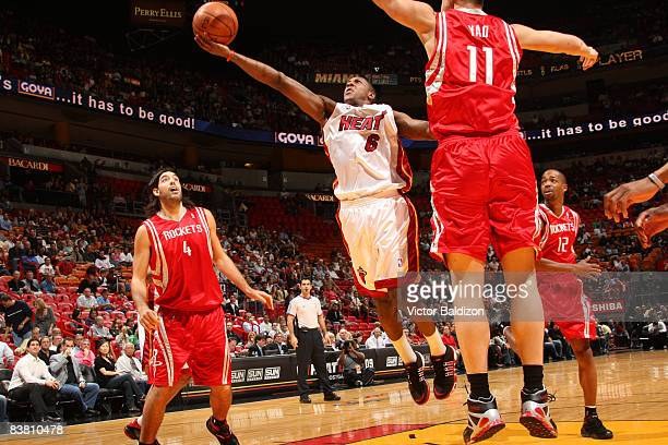 Mario Chalmers of the Miami Heat shoots against Yao Ming of the Houston Rockets on November 24 2008 at the American Airlines Arena in Miami Florida...