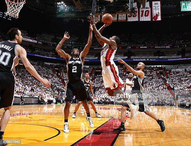 Mario Chalmers of the Miami Heat shoots over Kawhi Leonard of the San Antonio Spurs during Game Four of the 2014 NBA Finals at American Airlines...