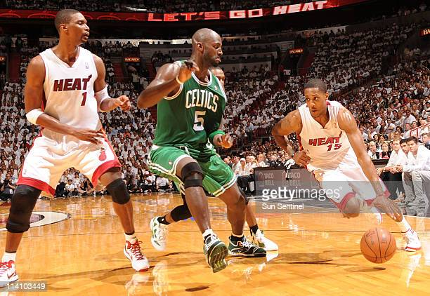 Mario Chalmers right of the Miami Heat drives past Kevin Garnett of the Boston Celtics in the second quarter of Game 5 of the NBA's Eastern...