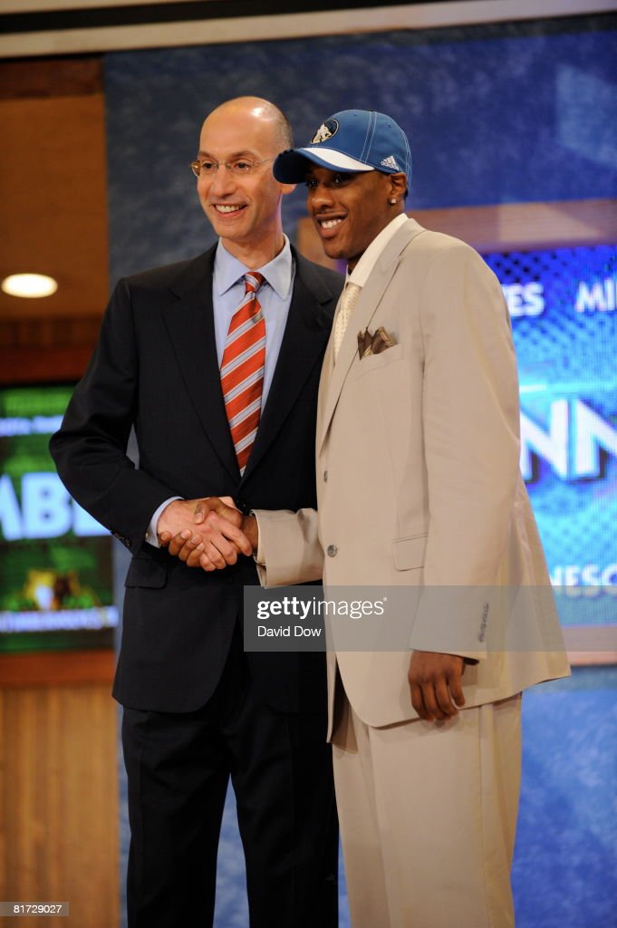 Mario Chalmers selected number thirty-four overall by the Minnesota Timberwolves shakes NBA Deputy Commissioner Adam Silver's hand during the 2008 NBA Draft at the WaMu Theatre at Madison Square Garden June 26, 2008 in New York City.
