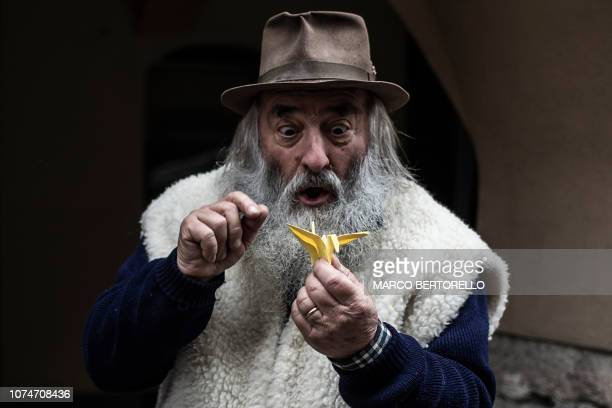 Mario Collino aka Prezzemolo performs his show on the streets on December 16 2018 in Busca near Cuneo Northern Italy Mario Collino a former worker at...