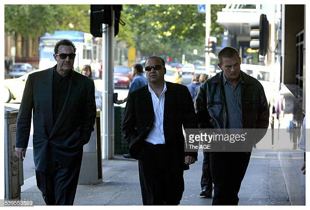 mario Condello far left arrives at the Melbourne Magistrates court to hear a remand hearing for Mick Gatto who has been charged with the murder of...