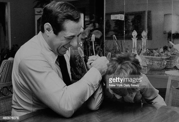 Mario Cuomo arm wrestles with son Christopher