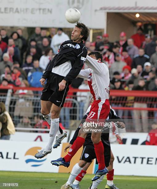 Mario Cvitanovic of Cottbus goes up for the ball with Christoph Dabrowski of Bochum during the Bundesliga match between Energie Cottbus and VFL...