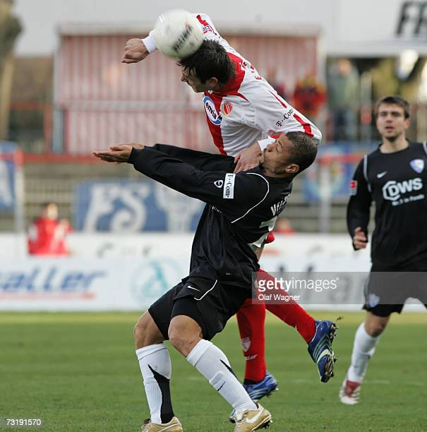 Mario Cvitanovic of Cottbus goes up for the ball with Joel Epalle of Bochum during the Bundesliga match between Energie Cottbus and VFL Bochum at the...