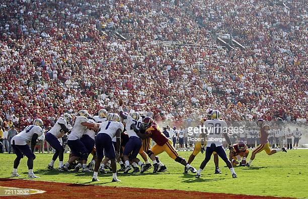 Mario Danelo and kicker for the USC Trojans kicks a field goal in the fourth quarter of the game against the Washington Huskies won by the Trojans...