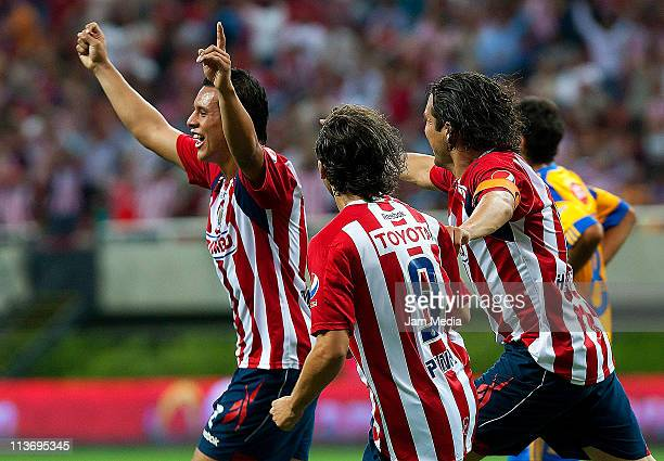 Mario de Luna of Chivas celebrates with teammates a scored goal during a match against Tigres during a quarter finals match as part of the Clausura...
