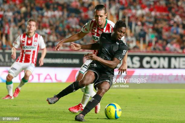 Mario de Luna of Necaxa fights for the ball with Aviles Hurtado of Monterrey during the 8th round match between Necaxa and Monterrey as part of the...