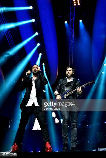 Mario Domm and Pablo Hurtado of Latin pop rock group Camila performs at James L Knight Center on July 18 2015 in Miami Florida