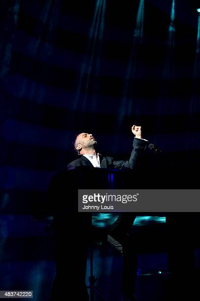 Mario Domm of Latin pop rock group Camila performs at James L Knight Center on July 18 2015 in Miami Florida
