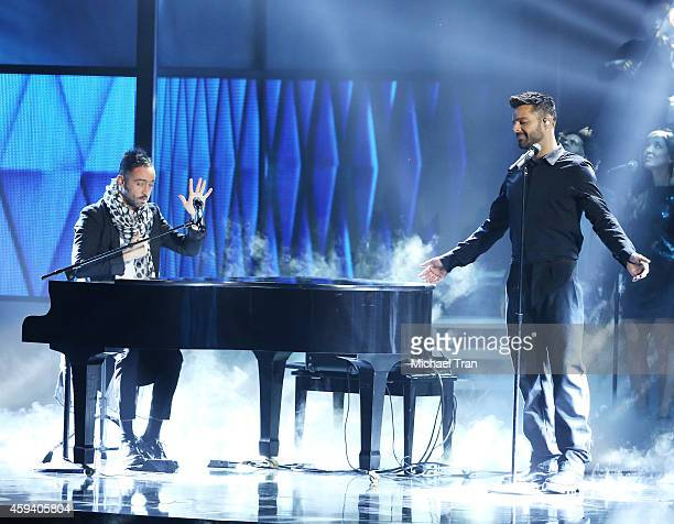 Mario Domm of music group Camila and Ricky Martin perform onstage during the 15th Annual Latin GRAMMY Awards held at the MGM Grand Arena on November...