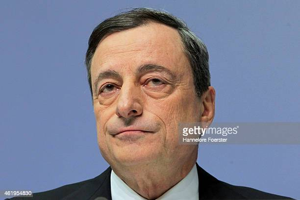 Mario Draghi head of the European Central Bank arrives to speak to journalists following a meeting of the ECB governing board on January 22 2015 in...