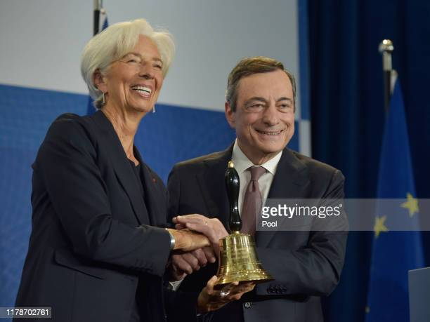 Mario Draghi outgoing president of the European Central Bank hands a ceremonial bell to Christine Lagarde former managing director of International...