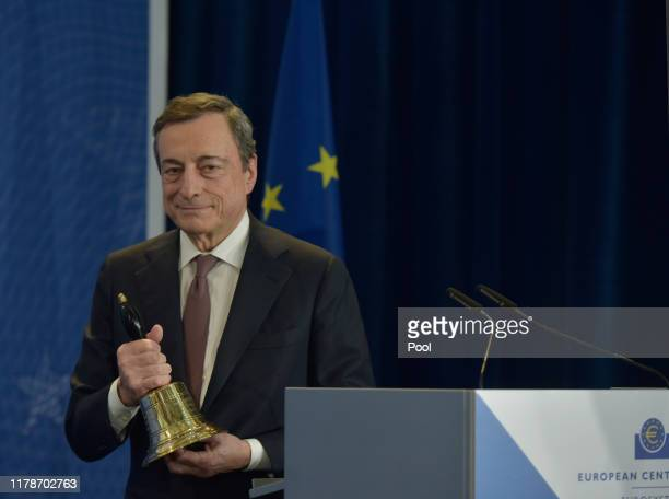 Mario Draghi, outgoing president of the European Central Bank , holds the ceremonial bell during his farewell ceremony at the headquarters of the...