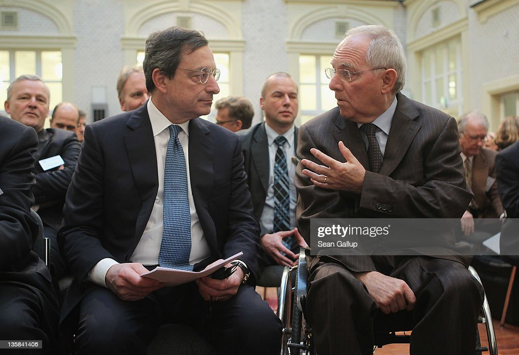 Mario Draghi (L), President of the European Central Bank (ECB), and German Finance Minister Wolfgang Schaeuble chat at the Ludwig Erhard Lecture on December 15, 2011 in Berlin, Germany. Draghi, in a speech later on, said a 'short term contraction' of the Eurozone economies is inevitable.
