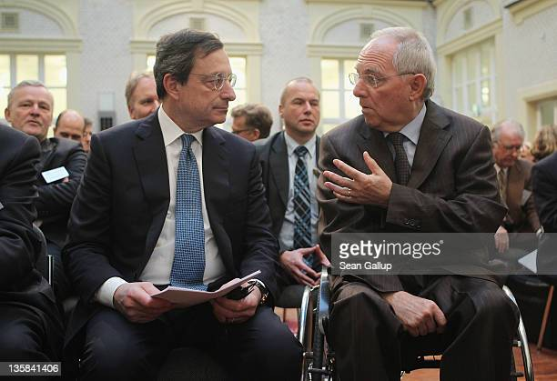 Mario Draghi President of the European Central Bank and German Finance Minister Wolfgang Schaeuble chat at the Ludwig Erhard Lecture on December 15...