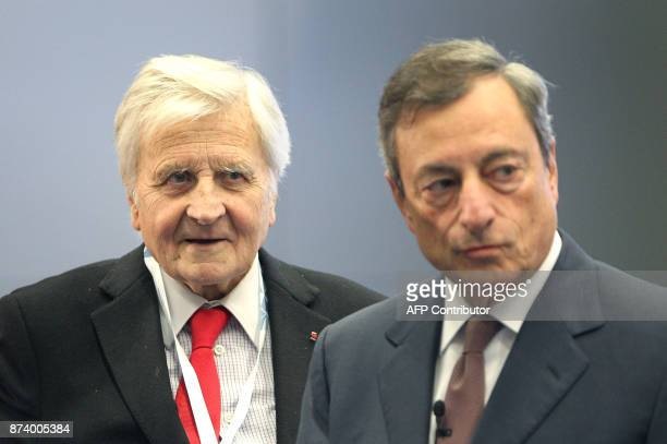 Mario Draghi President of the European Central Bank and his predecessor JeanClaude Trichet attend an ECB conference titled Communications Challenges...