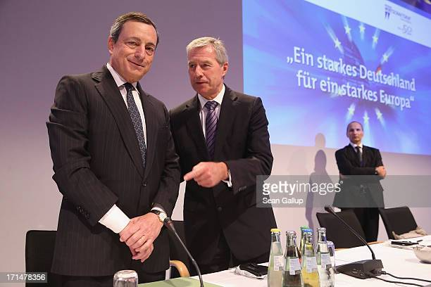 Mario Draghi president of the European Central Bank and Juergen Fitschen cohead of Deutsche Bank attend the 2013 German Economic Council conference...