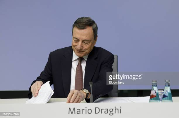 Mario Draghi president of the European Central Bank arranges documents during a news conference following the bank's interest rate decision at the...