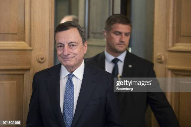 Mario Draghi president of the European Central Bank arrives for the ECB rate decision news conference at the Latvian central bank also known as...