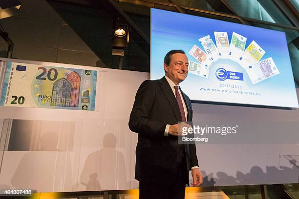 Mario Draghi president of the European Central Bank arrives to unveil a new twenty euro banknote at the ECB headquarters in Frankfurt Germany on...