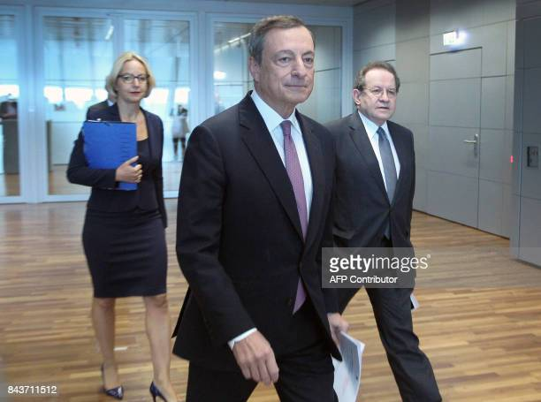 Mario Draghi President of the European Central Bank arrives with European Central Bank VicePresident Vitor Constancio and ECB spokeswoman Christine...