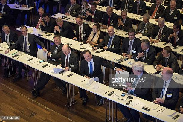 Mario Draghi president of the European Central Bank center laughs as he sits beside John Cryan chief executive officer of Deutsche Bank AG center...