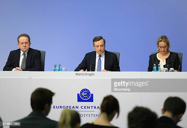 Mario Draghi president of the European Central Bank center pauses Vitor Constancio vice president of the European Central Bank left and Christine...