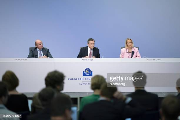 Mario Draghi president of the European Central Bank center sits flanked by Luis de Guindos vice president of the European Central Bank left and...