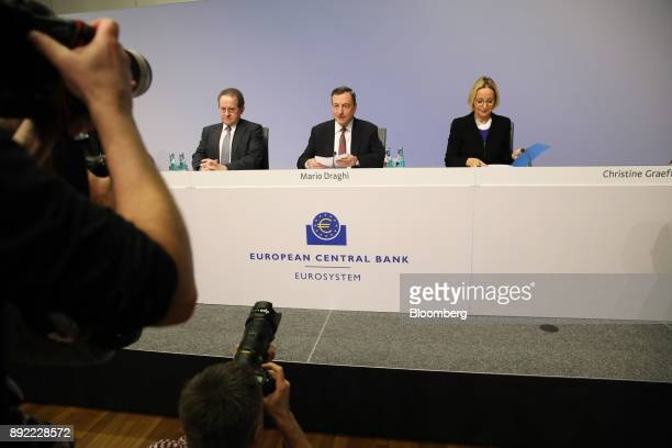 Mario Draghi president of the European Central Bank center speaks as Vitor Constancio vice president of the European Central Bank left and Christine...