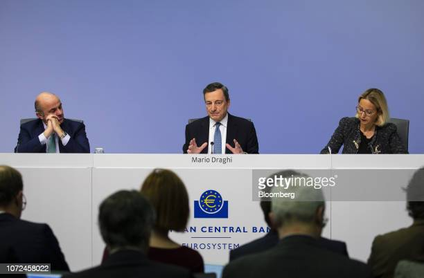 Mario Draghi president of the European Central Bank center speaks flanked by Luis de Guindos vice president of the European Central Bank left and...
