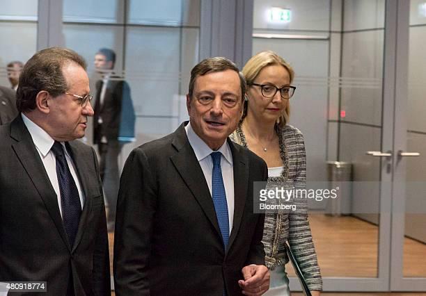Mario Draghi president of the European Central Bank center Vitor Constancio vice president of the European Central Bank left and Christine Claire...