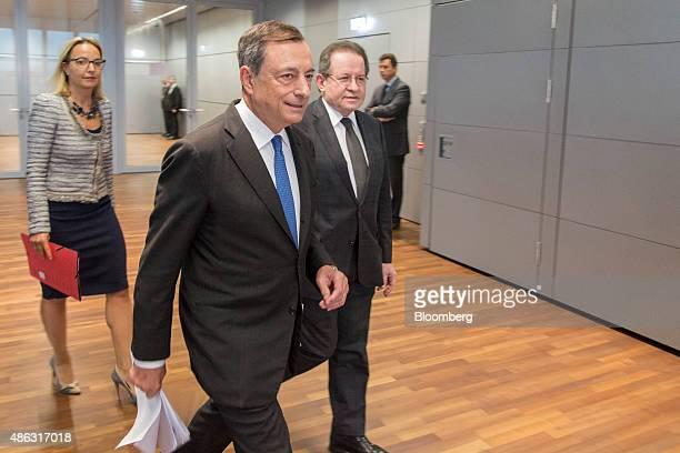 Mario Draghi president of the European Central Bank center Vitor Constancio vice president of the European Central Bank right and Christine Claire...