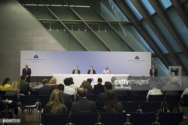 Mario Draghi president of the European Central Bank center Vitor Constancio vice president of the European Central Bank left and Christine Graeff...