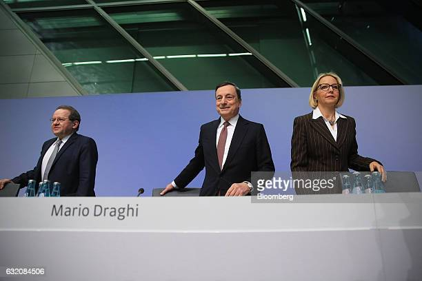 Mario Draghi president of the European Central Bank center Vitor Constancio vice president of the European Central Bank left and Christine Graeff...