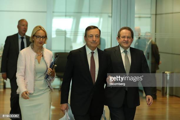 Mario Draghi president of the European Central Bank center Vitor Constancio vice president of the European Central Bank right and Christine Graeff...