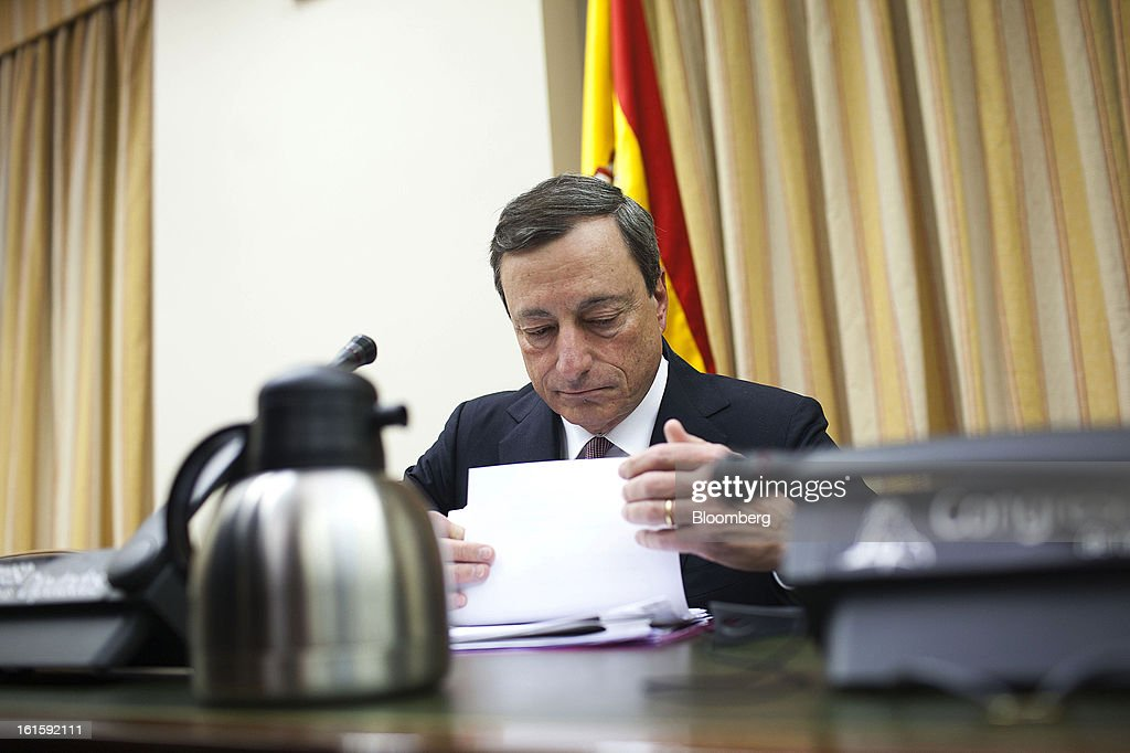 Mario Draghi, president of the European Central Bank (ECB), checks his papers before speaking at a news conference at the Spanish Congress in Madrid, Spain, on Tuesday, Feb. 12, 2013. Draghi said politicians should refrain from calling for intervention on the euro's exchange rate. Photographer: Angel Navarrete/Bloomberg via Getty Images